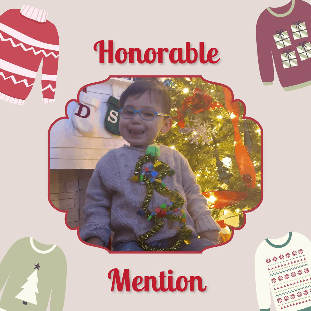 "A preschool boy with glasses wearing a sweater with a Christmas tree on it. Text reads ""Honorable Mention"""