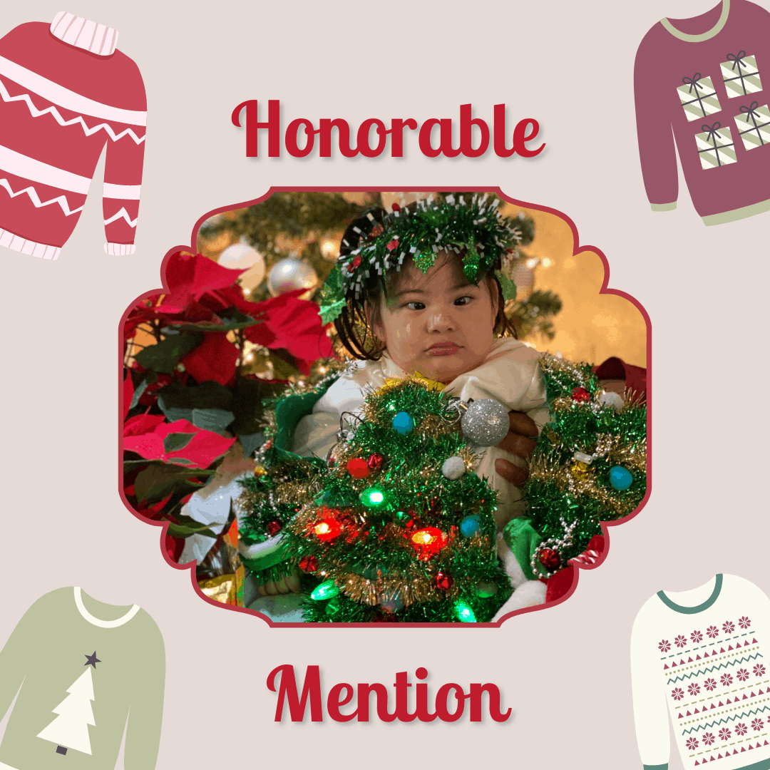 "A preschool girl wearing a Christmas tree costume. Text reads ""honorable mention"""